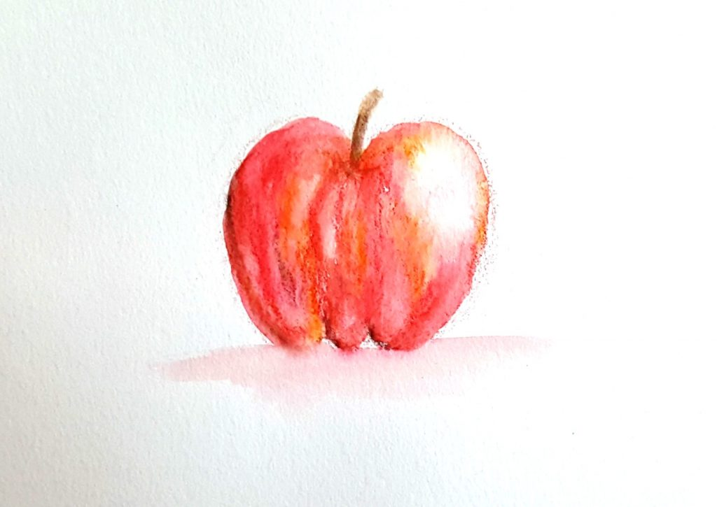 apple painted with watercolor pencils