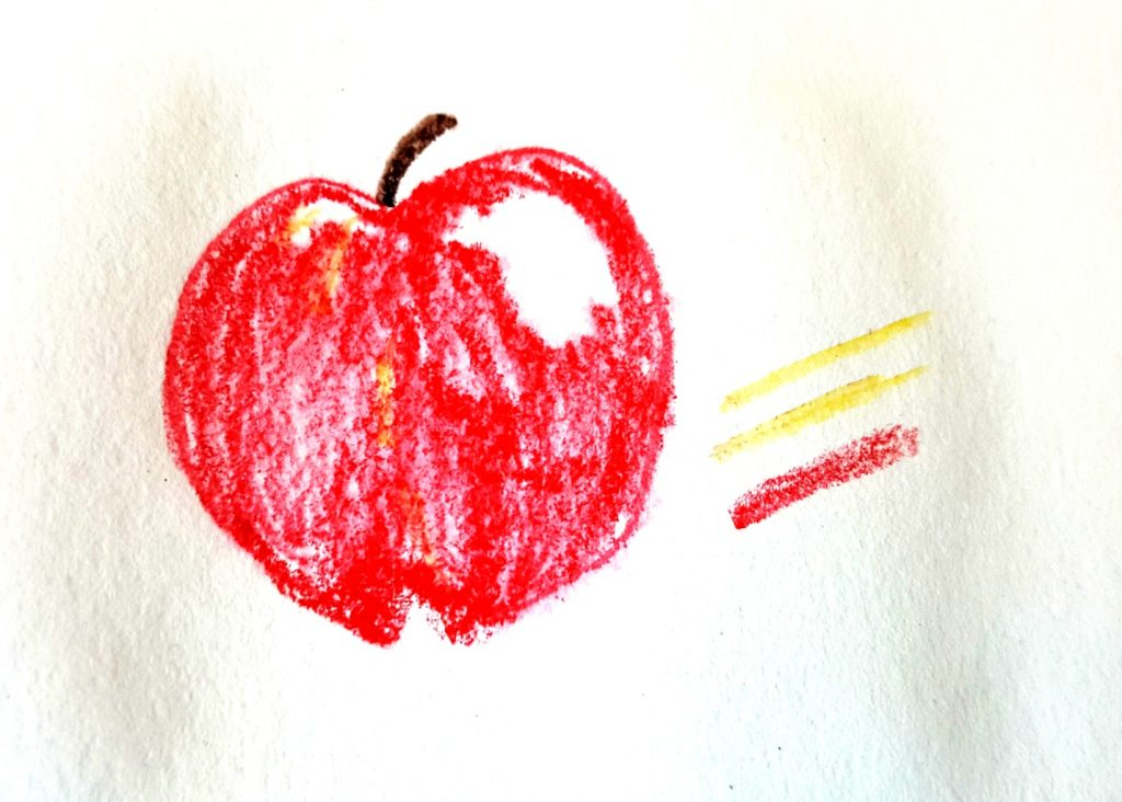 apple drawn with dry pencils on wet paper
