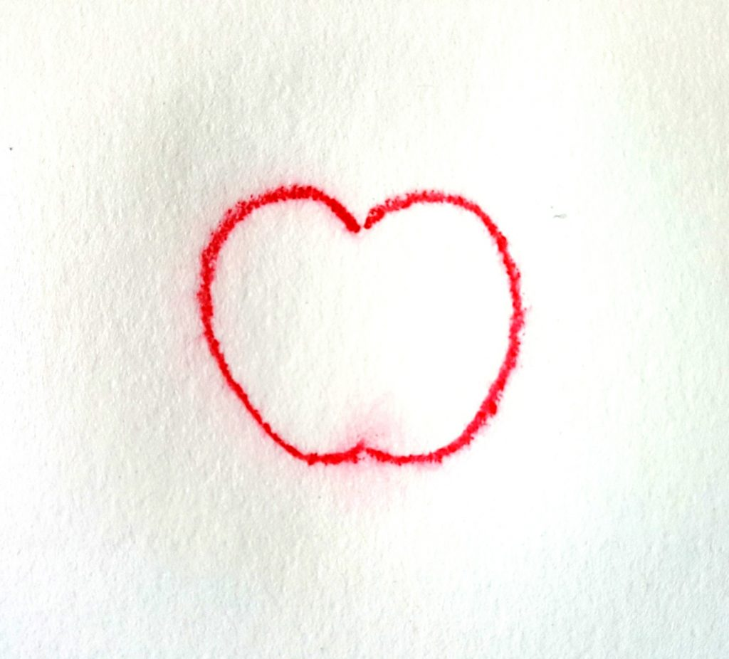 apple drawn with wet pencil on wet paper